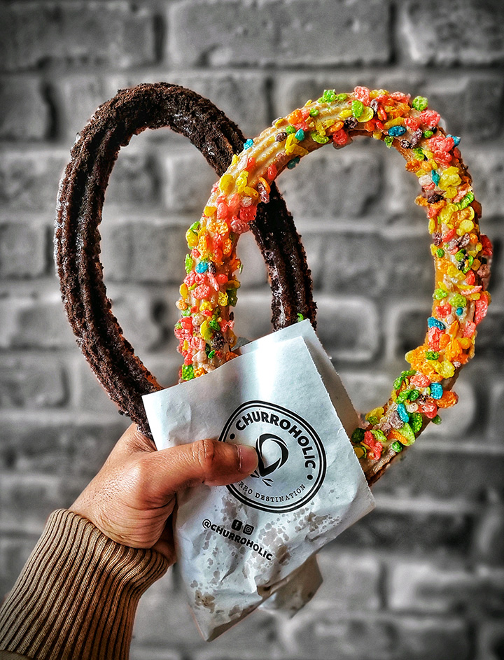 Two loop churros being held up