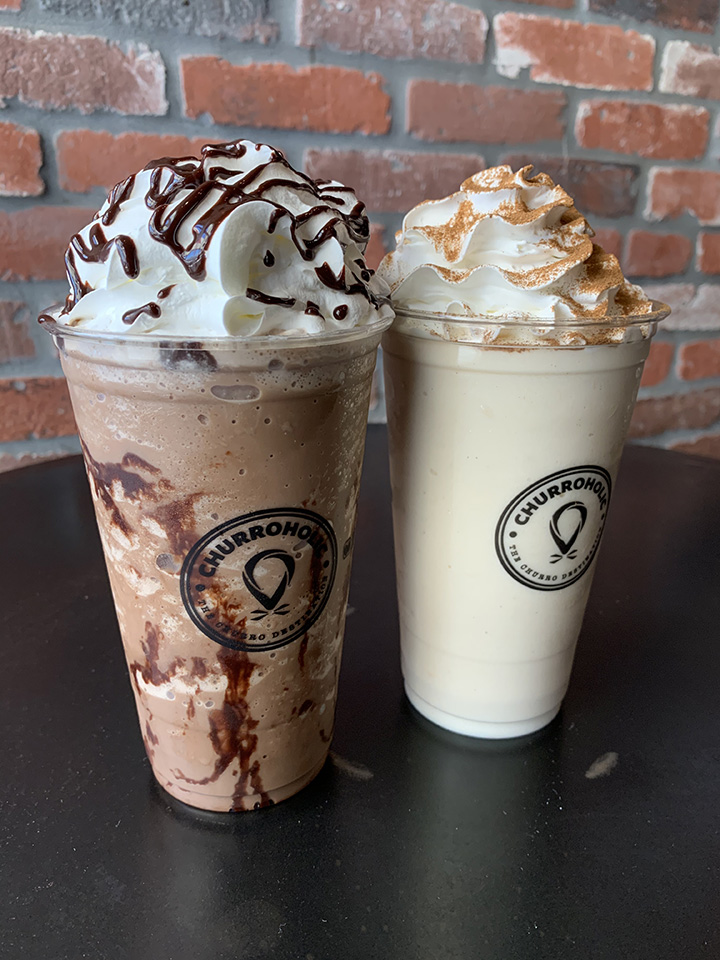 Two frappes on black table