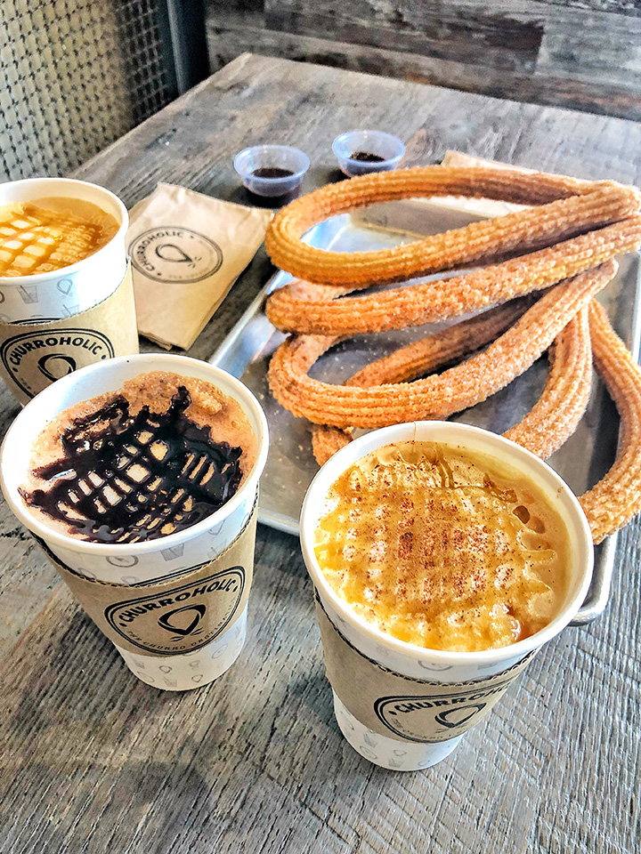 Hot coffee with a stack of churros